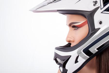 Beautiful girl with makeup in a helmet. Standard-Bild