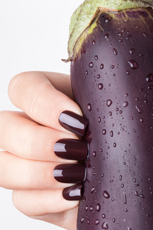 Blue nails on a white background. Very nice manicure. Standard-Bild