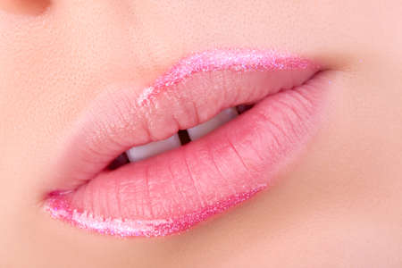 gloss: Pink lip gloss. Very nice lips close-up.