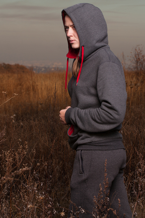 purposeful: The girl in sportswear is resting in the forest.