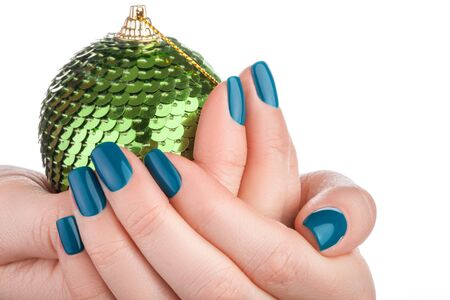 christmas toy: Beautiful green nails of Christmas toy.