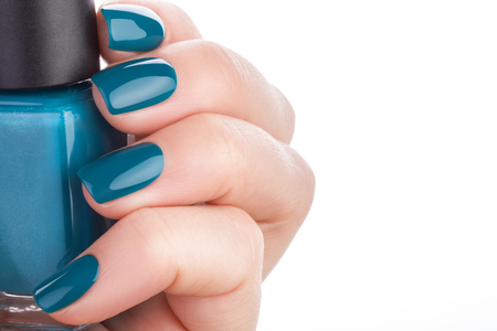 polish: Beautiful and neat nails green closeup. Stock Photo