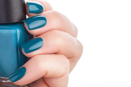 manicured hands: Beautiful and neat nails green closeup. Stock Photo