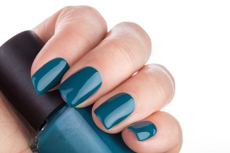 Beautiful and neat nails green closeup. Stock Photo