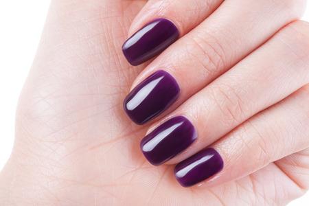 Beautiful burgundy nails close up.