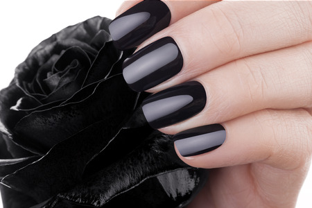 Very beautiful black nails closeup of a flower. Stock Photo