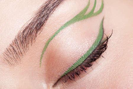 makeup eyes: Very colorful and beautiful makeup eyes closeup.