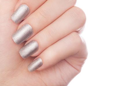 acrylic nails: Very beautiful silver metallic nails closeup. Stock Photo
