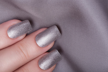 Very beautiful silver metallic nails closeup. Stock Photo