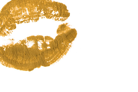 Yellow gold lipstick to natural lips close-up.