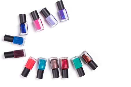 cosmetic lacquer: Many nail polish on a white background.