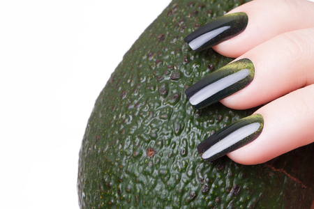 cosmetic lacquer: Very beautiful green cats eye close-up nails.
