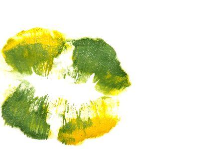 Yellowish green lipstick on natural closeup.