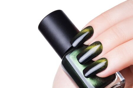 nails: Very beautiful green cats eye close-up nails.