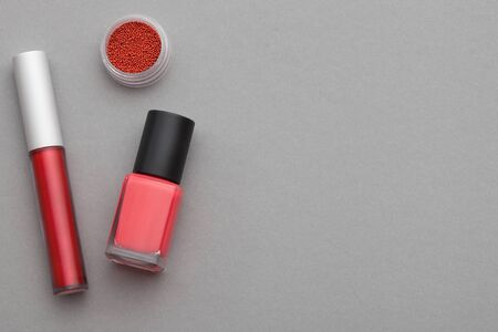 varnish for the nails: Various cosmetics on a gray background Stock Photo