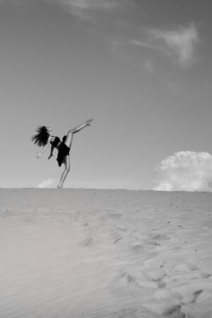 luscious: Fashionable the in the desert. The ballerina dances in the desert in the sand. Stock Photo