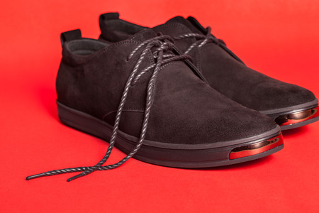 Beautiful black suede shoes. To advertise shoes. Stock Photo