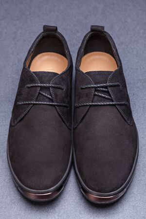 suede: Beautiful black suede shoes. To advertise shoes. Stock Photo