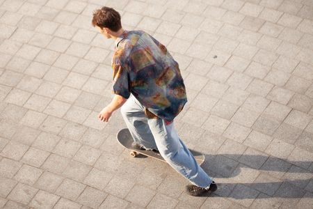 The guys on the skateboard ride on the street. Stock Photo