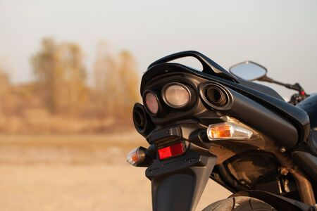 One black motorcycle in the desert in autumn time. Imagens
