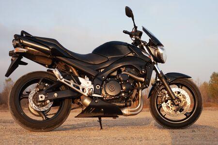 One black motorcycle in the desert in autumn time. Reklamní fotografie