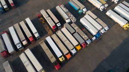 A photo of trucks with a trailer from a height. Stock Photo