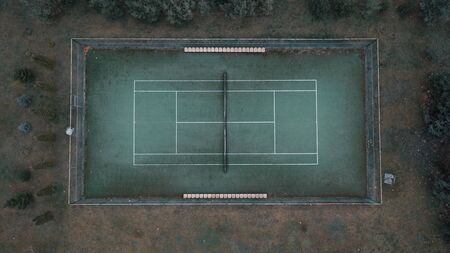 Photo of a tennis green field from a height.