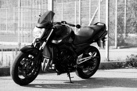 Black motorcycle close-up on the street.