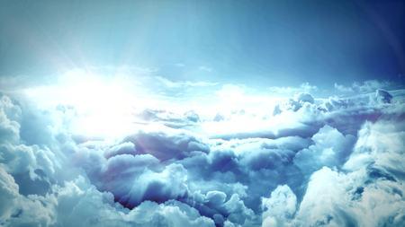 Flight over cloudscape to the sun Stock Photo
