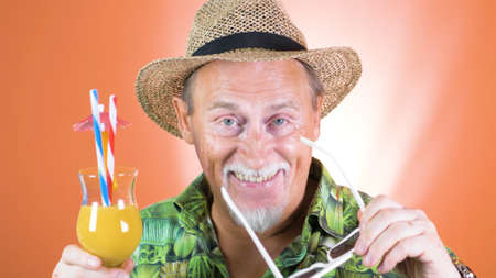 Studio portrait of the crazy grandfather on colored backgrounds. Peoples emotion. Happy and funny celebrating people.