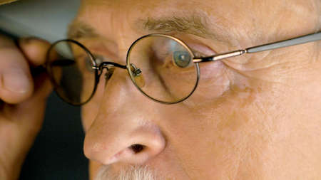 Men's eyes with glasses. Cropped shot of an elderly man with glasses.