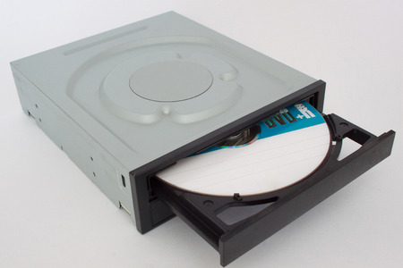 Opened CD - DVD drive with a black cap and disk inside. Stock Photo