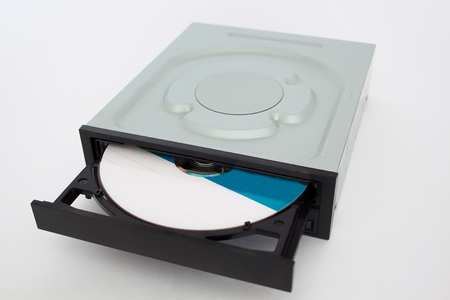optical disk: Opened CD - DVD drive with a black cap and disk inside. Isolated.