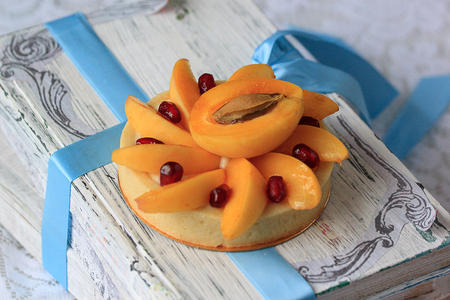 Appetizing tartlet with apricot and pomegranate. Sweeties dishes.