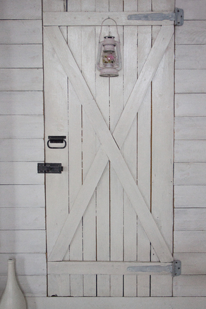 Wooden white door with old pendant lamp. Retro style.