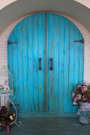 Beautiful front door in the house with an arch.