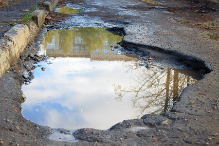 pit fall: The bad asphalted road with a big pothole.