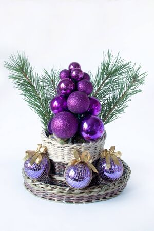 basketry: Christmas tree, sprigs of pine and balls for decoration. Stock Photo