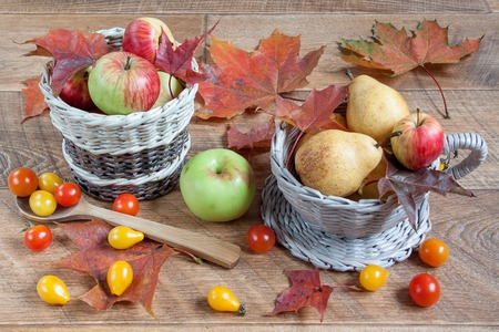 basketry: Autumn still life. Fruits, vegetables and maple leafs. Gifts of nature.