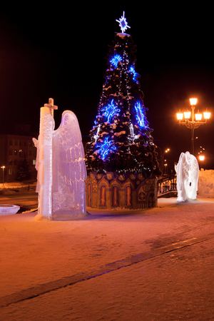 sobor: Russia, Izhevsk - January 29, 2017:Christmas tree and ice sculptures of angels are standing near the Svyato Mikhaylovsky sobor. Christmas holidays. Editorial