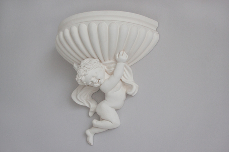 Beautiful stucco molding in the form of an angel. Retro style. Stock Photo