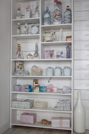 Shelves with various antique things. Rural style. Stock Photo