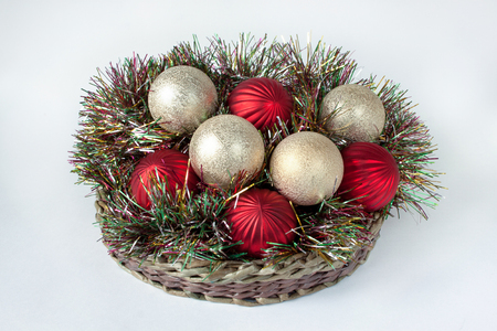christmas decorations are lying in a wicker basket isolated on a white background traditional - Christmas Basket Decorations