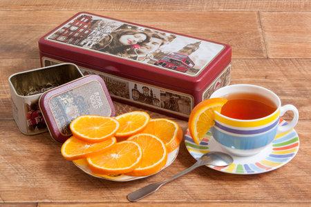 Russia, Izhevsk - May 15, 2017:Tea set Hilltop. A mixture of Ceylon black and Chinese green tea. Fresh orange.