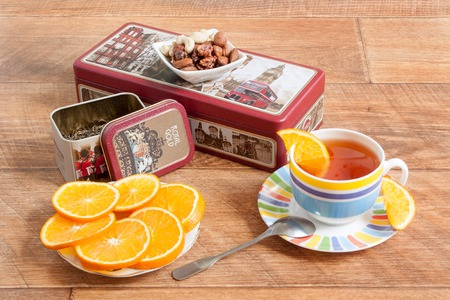 Russia, Izhevsk - May 15, 2017:Tea set Hilltop. Ceylon black and Chinese green tea. Fresh orange and nuts.