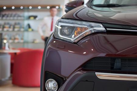Car dealership. New cars at dealer showroom. Prestigious vehicles.