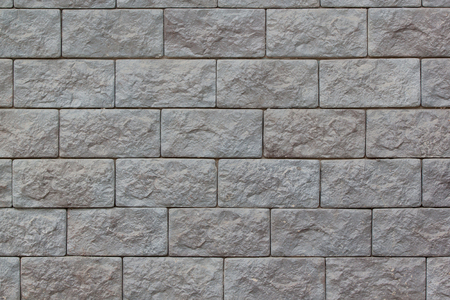 Brick wall with big gray bricks. Used as a background. Copy space for your text. 版權商用圖片