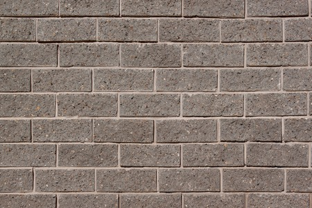 The wall of the house is lined with gray bricks. Used as a background. Copy space for your text.