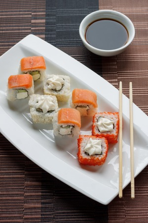 Traditional japanese seafood, roll and chopstick. Soy souce.