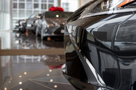 New cars at dealer showroom. For use as a background. Modern and prestigious vehicles. Standard-Bild - 111402087